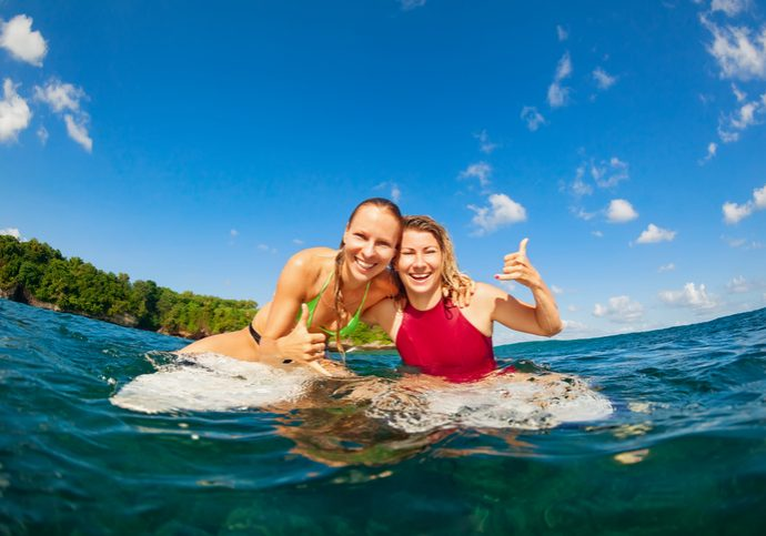 Happy girls getting surf lessons in Haleiwa